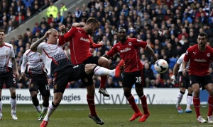 Liverpool's Martin Skrtel, left, scores his team's second against Cardiff City in the Premier League