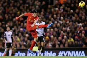 Luis-Suarez-of-Liverpool-scores-his-first-goal-2946543
