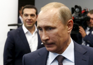 Russian President Vladimir Putin (front) and Greek Prime Minister Alexis Tsipras arrive for a meeting at the St. Petersburg International Economic Forum 2015 (SPIEF 2015) in St. Petersburg, Russia, June 19, 2015. REUTERS/Grigory Dukor