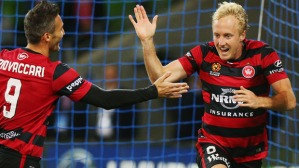 MELBOURNE, AUSTRALIA - NOVEMBER 13:  Mitch Nichols of the Wanderers celebrates a goal with Frederico Piovaccari (L) during the round six A-League match between Melbourne City FC and the Western Sydney Wanderers at AAMI Park on November 13, 2015 in Melbourne, Australia.  (Photo by Michael Dodge/Getty Images)