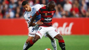 SYDNEY, AUSTRALIA - DECEMBER 12:  Romeo Castelen of the Wanderers is challenged by Daniel Georgievski of Melbourne Victory during the round 10 A-League match between the Western Sydney Wanderers and Melbourne Victory at Pirtek Stadium on December 12, 2015 in Sydney, Australia.  (Photo by Matt King/Getty Images)
