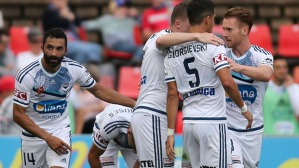 NEWCASTLE, AUSTRALIA - JANUARY 03:  Melbourne Victory players celebrate a goal during the round 13 A-League match between the Newcastle Jets and Melbourne Victory at Hunter Stadium on January 3, 2016 in Newcastle, Australia.  (Photo by Tony Feder/Getty Images)