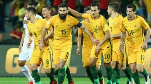 ADELAIDE, AUSTRALIA - MARCH 24:  Mile Jedinak of Australia celebrates with team mates after scoring a goal during the 2018 FIFA World Cup Qualification match between the Australia Socceroos and Tajikistan at the Adelaide Oval on March 24, 2016 in Adelaide, Australia.  (Photo by Cameron Spencer/Getty Images)