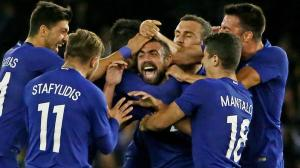 MELBOURNE, AUSTRALIA - JUNE 07: Giannis Maniatis of Greece is congratulated by his teammates after kicking a goal from half way during the International Friendly match between the Australian Socceroos and Greece at Etihad Stadium on June 7, 2016 in Melbourne, Australia. (Photo by Scott Barbour/Getty Images)